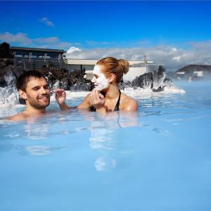 Reykjavik city break: couple relaxing at spa Blue Lagoon, south of Iceland.